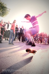 Skateboard intermezzo: in between songs, doing a stunt for the audience